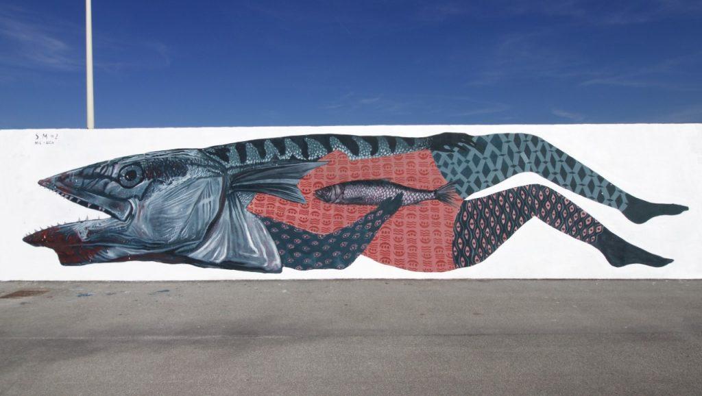 Una delle opere di Nicola Alessandrini e Lisa Gelli, nello stile che caratterizzerà anche il nuovo murales di via San Giuseppe