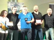 Al centro Stefano Ravoni (Ciarnin) premiato come miglior allenatore della serie D al galà del calcio a 5