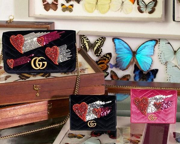 Pochette e portafogli Gucci impreziositi di applique