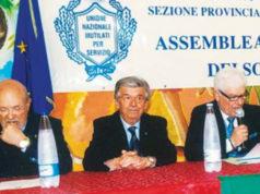 Al centro, Claudio Giovanetti, responsabile regionale dell'Unione nazionale Mutilati per servizio