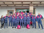 Italservice Pesaro al completo davanti al palasport di Almaty, in Kazakistan