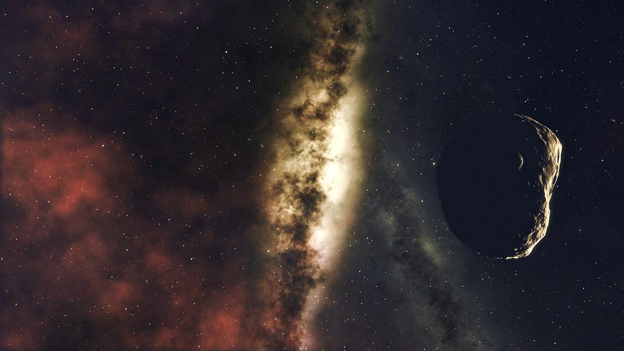 galassia e asteroide: Immagine di CharlVera tratta da Pixabay