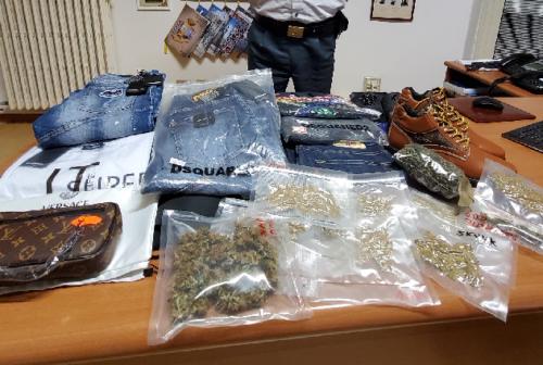 Merce contraffatta e marijuana nascoste in casa: nei guai due fratelli civitanovesi